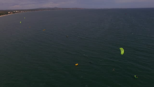 aerial wide of finish line of kite surf race - kite sailing stock videos and b-roll footage