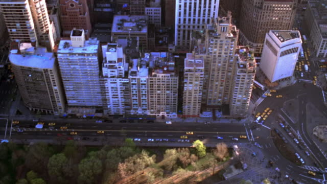 aerial wide shot along central park south over columbus circle and skyscrapers on broadway/manhattan, nyc - columbus circle stock videos & royalty-free footage