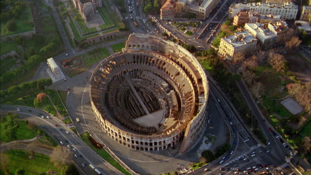 aerial wide shot coliseum / rome - rome italy stock videos & royalty-free footage