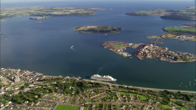 aerial wide shot cruise ship moored in cork harbour/ zoom in overhead cruise ship/ cork, ireland - county cork stock videos & royalty-free footage