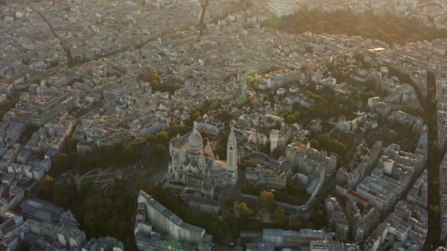 aerial wide shot flying around the sacré-cœur in paris france, sunset - basilique du sacre coeur montmartre stock videos & royalty-free footage