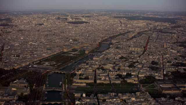 aerial wide shot flying over paris france looking east, dusk - grand palais stock videos & royalty-free footage