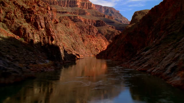 aerial wide shot moving along colorado river in the grand canyon/ nevada - canyon stock videos & royalty-free footage