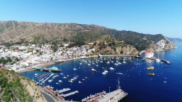 Aerial, wide shot of boats docked off Catalina Island