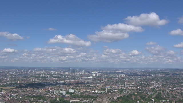 aerial wide shot of london sunny day, with city of london and the o2 in distance - 晴れている点の映像素材/bロール