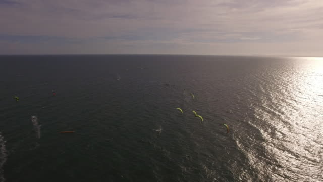 aerial wide shot of the beginning of a kite surf race - kite sailing stock videos and b-roll footage