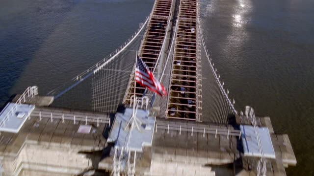 aerial wide shot over brooklyn bridge with traffic / nyc - brooklyn bridge stock videos and b-roll footage