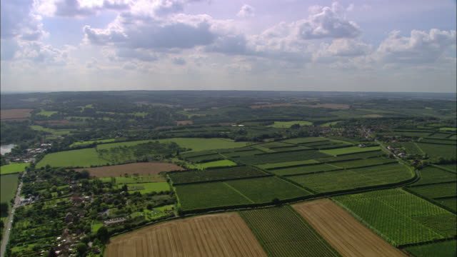 Aerial wide shot over fruit farms near Canterbury / Kent, England
