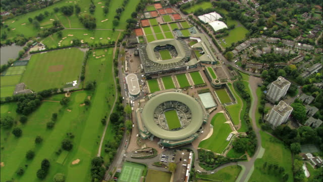 Aerial wide shot pan  All England Lawn Tennis and Croquet Club and surrounding area / Wimbledon