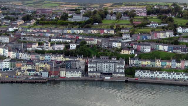 aerial wide shot pan buildings on coast of cork harbour / cork, ireland - county cork stock videos & royalty-free footage