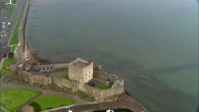 aerial wide shot pan carrickfergus castle and belfast lough/ county antrim, northern ireland - ulster county stock videos & royalty-free footage
