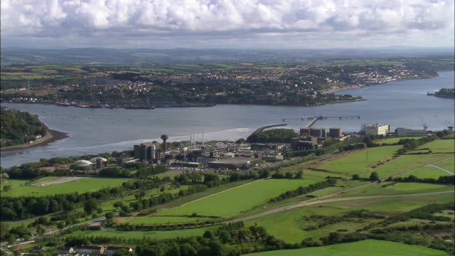 aerial wide shot pan cork and cork harbour / ireland - county cork stock videos & royalty-free footage