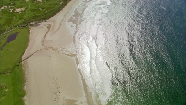 Aerial wide shot pan deserted beach on island of Islay / Argyll and Bute, Scotland