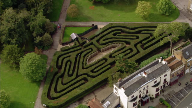 aerial wide shot pan hampton court palace maze / surrey, england - maze stock videos and b-roll footage