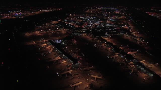 Aerial wide shot pan Heathrow Airport at night / London, England