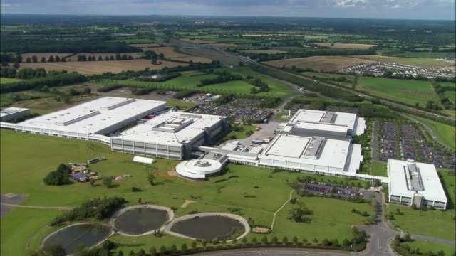 aerial wide shot pan large industrial complex/ dublin, ireland - plant stock videos & royalty-free footage