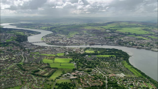 aerial wide shot pan londonderry and river foyle / county derry, ireland - northern ireland stock videos & royalty-free footage