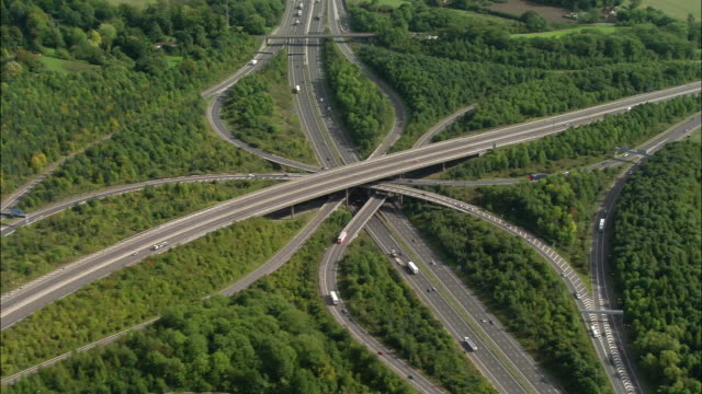 aerial wide shot pan m25 and m23 junction / surrey, england - m25 video stock e b–roll