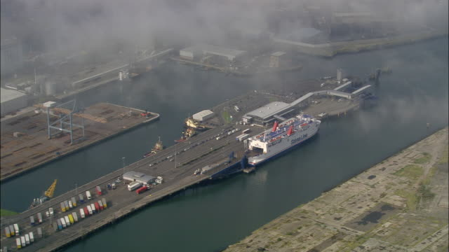 aerial wide shot pan moored ferry at belfast docks/ northern ireland - belfast stock videos & royalty-free footage