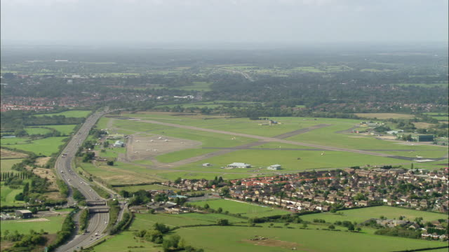 aerial wide shot pan northolt airport, motorway, and surrounding residential area / london, england - surrounding stock videos and b-roll footage