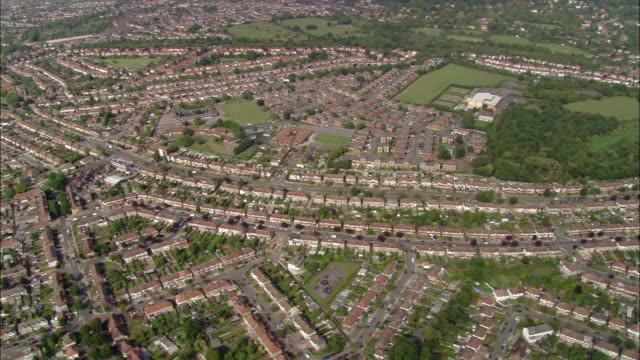 aerial wide shot pan rows of houses in suburbs of greenford / london, england - ealing stock videos and b-roll footage