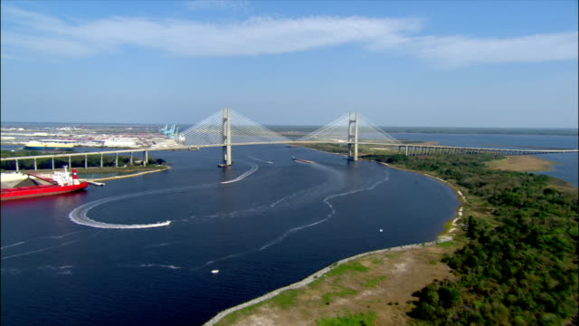 aerial wide shot pan st. james river toward and over dames point bridge/ jacksonville, florida - jacksonville florida stock videos and b-roll footage