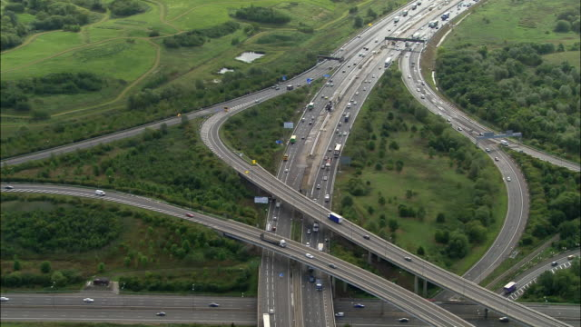 Aerial wide shot pan traffic at junction M4 and M25 / London, England