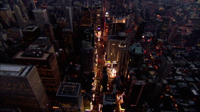 aerial wide shot pan up broadway to times square at night/ new york city - broadway manhattan stock-videos und b-roll-filmmaterial