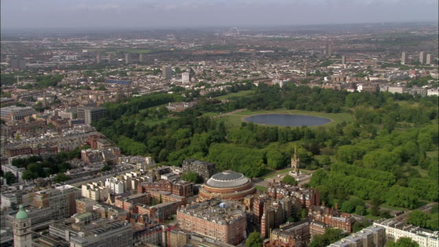 aerial wide shot pan view of kensington over albert hall and hyde park / london, england - royal albert hall stock videos and b-roll footage