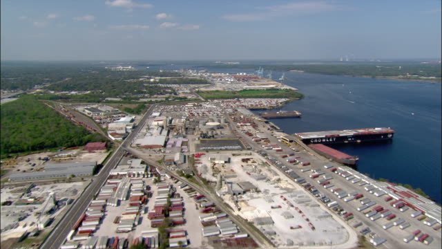 aerial wide shot pan waterfront industrial area and freight yards/ jacksonville, florida - jacksonville florida video stock e b–roll
