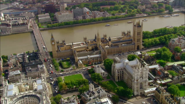 Aerial wide shot pan Westminster Abbey and Houses of Parliament / London, England