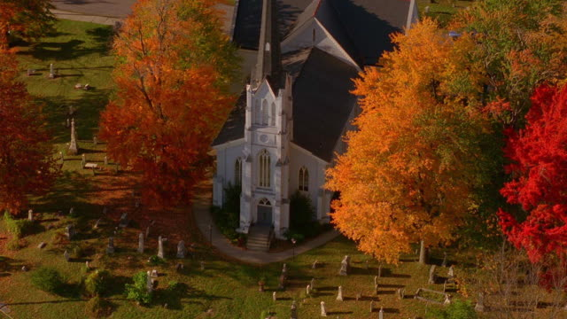 aerial wide shot point of view over church and cemetery / maine - cemetery stock videos & royalty-free footage
