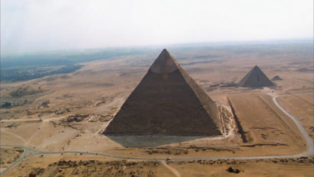 Aerial wide shot Pyramid of Chephren and Mycerinus in desert / Giza, Egypt
