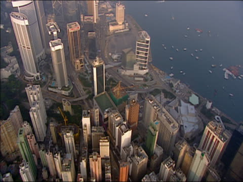 aerial wide shot skyscrapers and waterfont/ hong kong - bank of china tower hong kong stock videos and b-roll footage