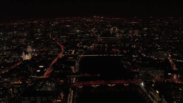 aerial wide shot thames and bridges with saint paul's cathedral and cityscape / london, england - london bridge england stock videos & royalty-free footage