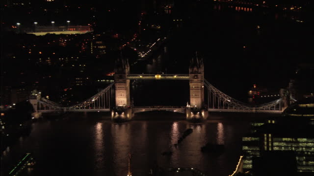 Aerial wide shot Tower Bridge and Thames / zoom out other bridges and cityscape / London, England
