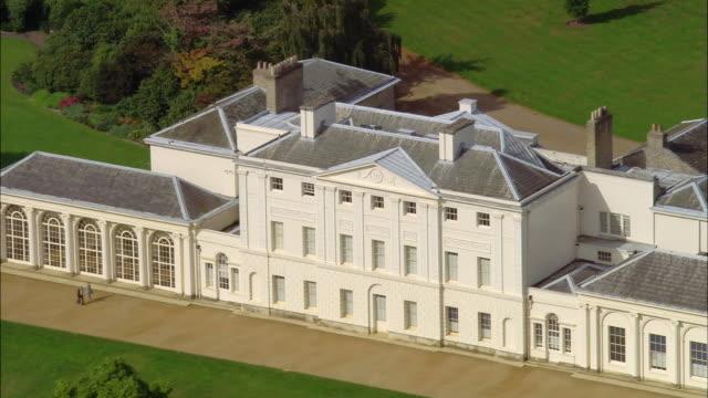 Aerial wide shot zoom out pan  Kenwood House / Overhead Kenwood and Hampstead Heath / London, England