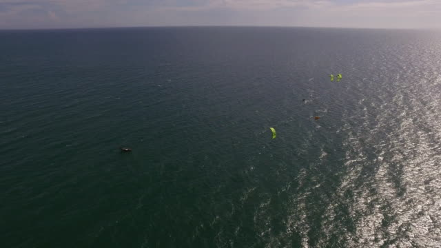 Aerial wide top shot of kite foil boarders