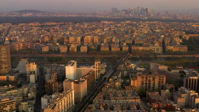 aerial wide view flying over elevated subway in paris france towards la defance, sunrise - railway track stock videos & royalty-free footage