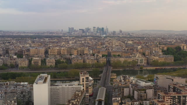 aerial wide view flying over paris france, flying towards la defance at sunrise - île de france stock-videos und b-roll-filmmaterial