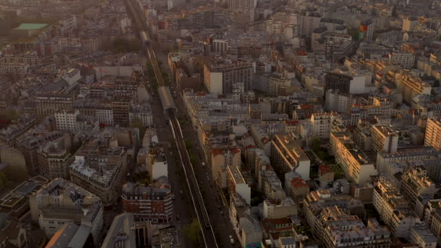 aerial wide view flying over paris france, looking down at elevated subway, sunrise - underground train stock videos & royalty-free footage