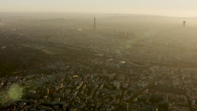 aerial wide view of eiffel tower and the rest of the city of paris france at sunrise - paris france stock videos & royalty-free footage