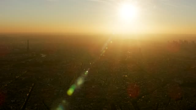 vidéos et rushes de aerial wide view of paris france with eiffel tower, sunset - soleil