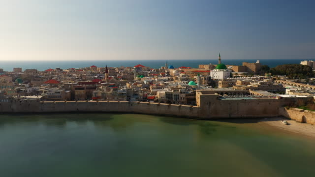 aerial: wide view of the old city of acre, small beach and marina - akko stock videos and b-roll footage