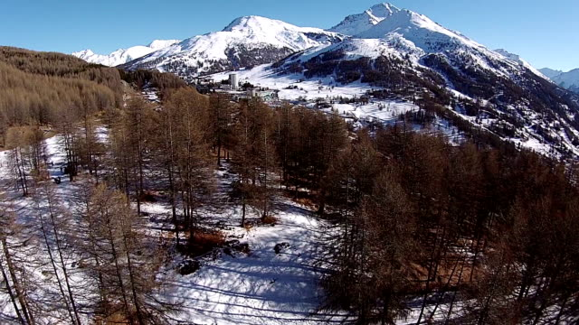 aerial - winter in italian alps - sestriere - piedmont italy stock videos & royalty-free footage