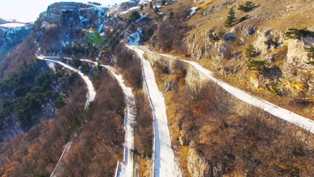 Aerial Winter mountain winding road