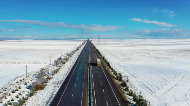 aerial winter road highway, snow, drone - general view stock videos & royalty-free footage