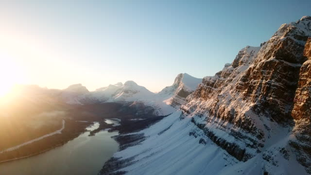 aerial | winter wonderland | bow lake - mountain range stock videos & royalty-free footage