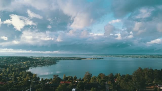 aerial with dramatic clouds - curve stock videos & royalty-free footage
