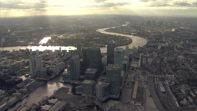 Aerial W/S City of London with Canary Wharf foreground with God-Rays
